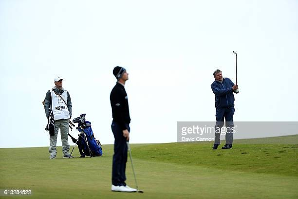 Thomas Pieters of Belgium watches his playing partner Johann Rupert of South Africa on the18th hole during the second round of the Alfred Dunhill...