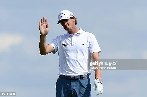 Thomas Pieters of Belgium waves on the 8th hole during a proam round ahead of the DD REAL Czech Masters at Albatross Golf Resort on August 17 2016 in...