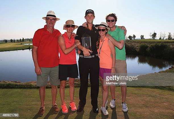Thomas Pieters of Belguim celebrates with his family after winning the DD Real Czech Masters at the Albatross Golf Resort on August 30 2015 in Prague...
