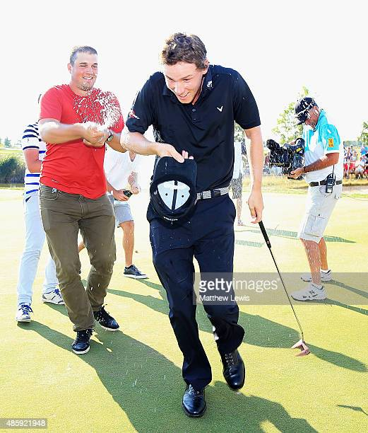 Thomas Pieters of Belguim is sparyed with champagne after winning the DD Real Czech Masters at the Albatross Golf Resort on August 30 2015 in Prague...
