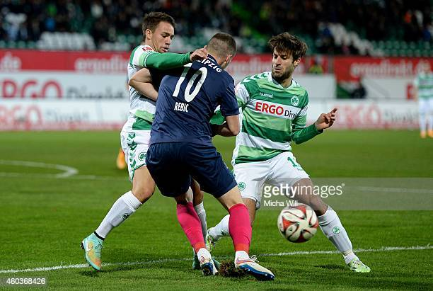 Thomas Pledl of Fuerth Ante Rebic of Leipzig and Marco Caligiuri of Fuerth compete for the ball during the Second Bundesliga match between SpVgg...
