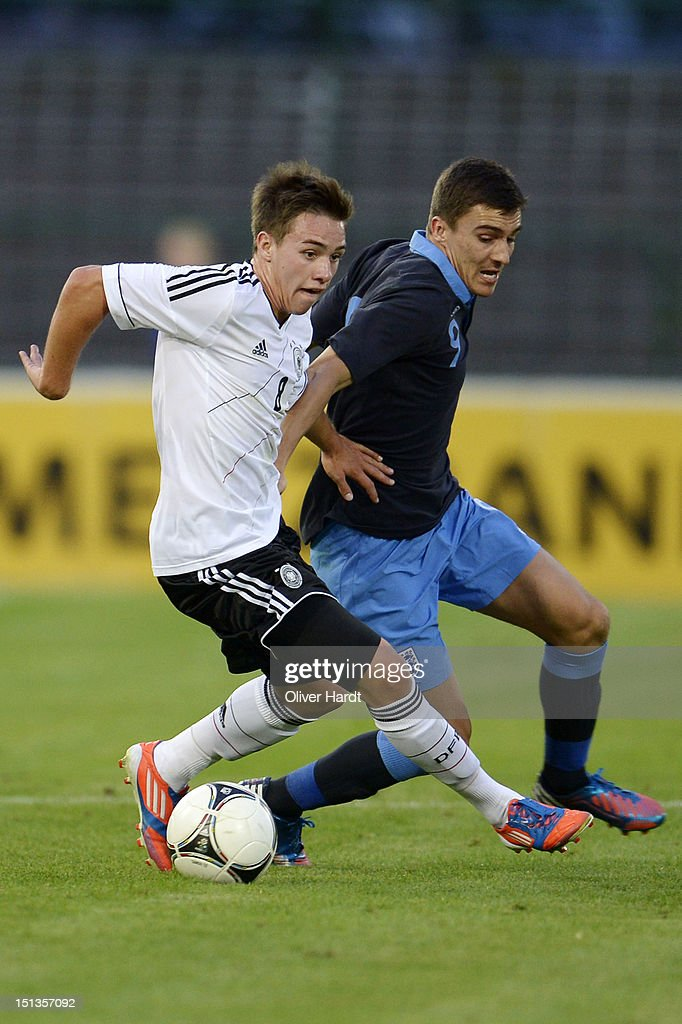Thomas Pledl (L) of Germany and Adam Morgan (R) of England battle for the ball during the Under 19 international friendly match between Germany and England at Stadion an der Lohmuehle on September 6, 2012 in Luebeck, Germany.