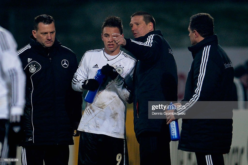 Thomas Pledl of Germany gets instructions from head coach <a gi-track='captionPersonalityLinkClicked' href=/galleries/search?phrase=Christian+Ziege&family=editorial&specificpeople=242786 ng-click='$event.stopPropagation()'>Christian Ziege</a> during the International Friendly match between U19 Germany and U19 Spain on March 20, 2013 in Duesseldorf, Germany.