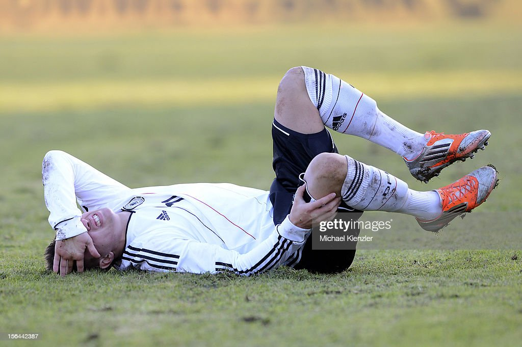 Thomas Pledl of Germany lying injured on the field during the International Friendly match between U19 Germany and U19 France at Rheinstadium on November 14, 2012 in Kehl, Germany.