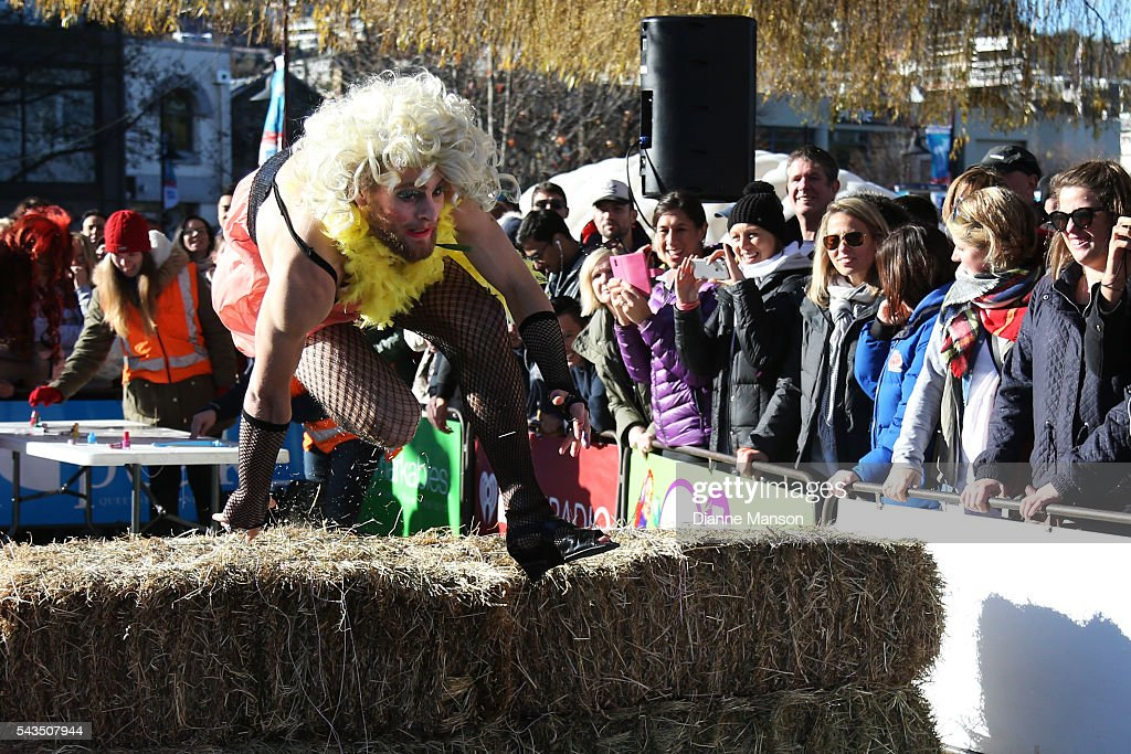 Thomas Prebble jumps the hay bale during the Downtown Day Drag race at the Queenstown Winter Festival on June 29, 2016 in Queenstown, New Zealand.
