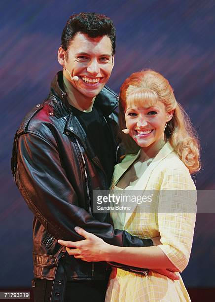 Thomas Puskailer as Danny and Jennifer Farmer as Sandy pose on stage during a photocall for the musical 'Grease' on September 6 2006 in Munich Germany