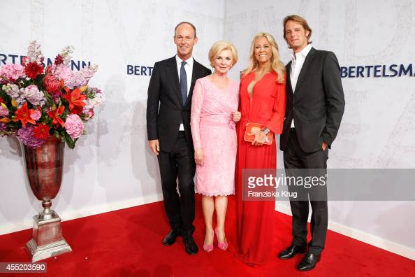 Thomas Rabe Liz Mohn Jenny Elvers and Steffen von der Beeck attend the Bertelsmann Summer Party at the Bertelsmann representative office on September...