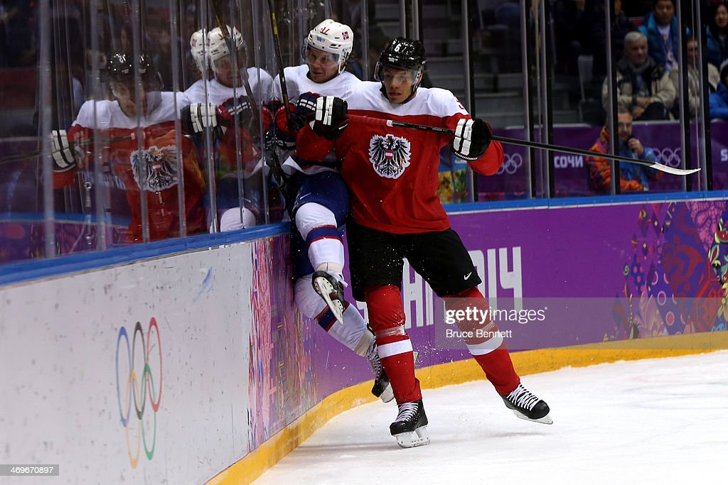 Thomas Raffl #5 of Austria checks <a gi-track='captionPersonalityLinkClicked' href=/galleries/search?phrase=Patrick+Thoresen&family=editorial&specificpeople=637009 ng-click='$event.stopPropagation()'>Patrick Thoresen</a> #41 of Norway during the Men's Ice Hockey Preliminary Round Group B game on day nine of the Sochi 2014 Winter Olympics at Bolshoy Ice Dome on February 16, 2014 in Sochi, Russia.
