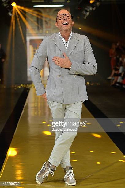 Thomas Rath celebrates his show during Platform Fashion Dusseldorf on July 27 2014 in Duesseldorf Germany