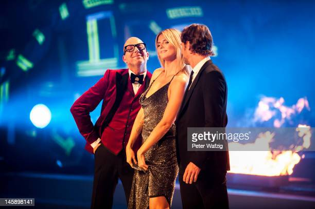 Thomas Rath Heidi Klum and Thomas Hayo during the opening part of 'Germany's Next Topmodel' Finals at the LanxessArena on June 07 2012 in Cologne...