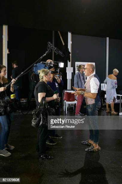 Thomas Rath is interviewed backstage ahead of the Thomas Rath show during Platform Fashion July 2017 at Areal Boehler on July 23 2017 in Duesseldorf...