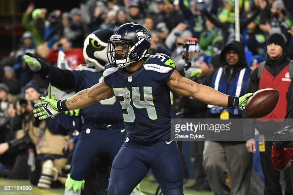 Thomas Rawls of the Seattle Seahawks celebrates scoring a 4yard touchdown during the fourth quarter against the Detroit Lions in the NFC Wild Card...