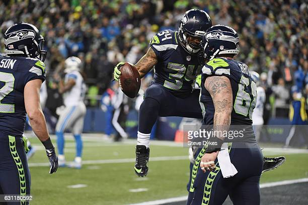 Thomas Rawls of the Seattle Seahawks celebrates with Justin Britt after scoring a 4yard touchdown during the fourth quarter against the Detroit Lions...