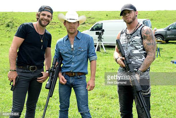 Thomas Rhett Justin Moore and Brantley Gilbert on the set of Brantley Gilbert's 'Small Town Throwdown' video shoot on June 30 2014 in Nashville...