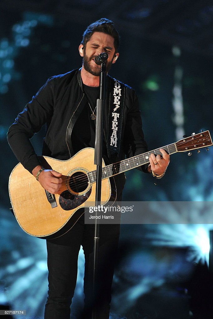 <a gi-track='captionPersonalityLinkClicked' href=/galleries/search?phrase=Thomas+Rhett&family=editorial&specificpeople=9092574 ng-click='$event.stopPropagation()'>Thomas Rhett</a> performs at the 2016 American Country Countdown Awards at The Forum on May 1, 2016 in Inglewood, California.