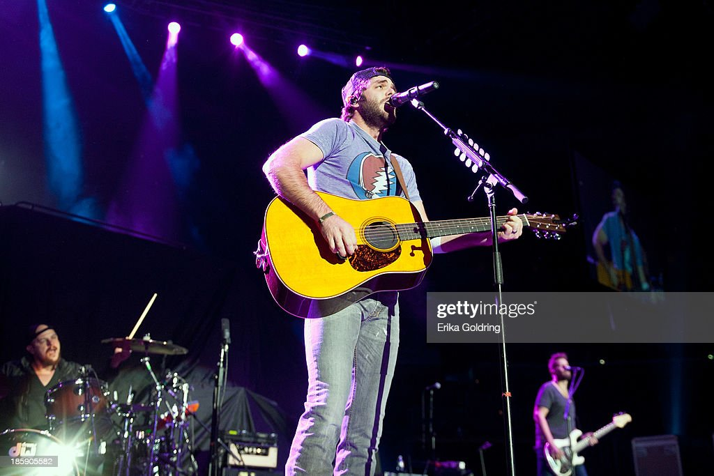 <a gi-track='captionPersonalityLinkClicked' href=/galleries/search?phrase=Thomas+Rhett&family=editorial&specificpeople=9092574 ng-click='$event.stopPropagation()'>Thomas Rhett</a> performs during Jason Aldean's 8th annual Susan G. Komen Concert for the Cure at New Orleans Arena on October 25, 2013 in New Orleans, Louisiana.