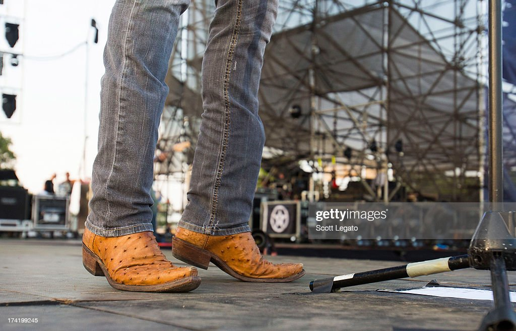 Thomas Rhett (shoe detail) performs during the 2013 Faster Horses Festival on July 21, 2013 in Brooklyn, Michigan.