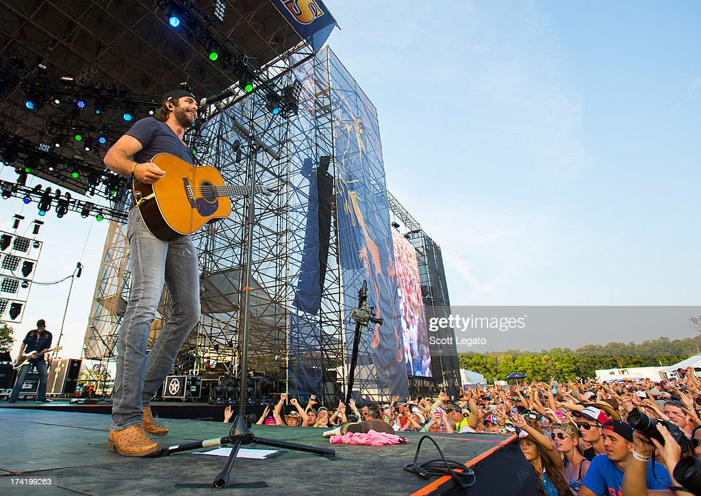 Thomas Rhett performs during the 2013 Faster Horses Festival on July 21, 2013 in Brooklyn, Michigan.