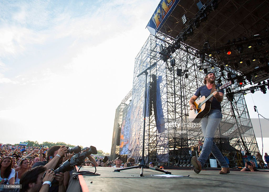<a gi-track='captionPersonalityLinkClicked' href=/galleries/search?phrase=Thomas+Rhett&family=editorial&specificpeople=9092574 ng-click='$event.stopPropagation()'>Thomas Rhett</a> performs during the 2013 Faster Horses Festival on July 21, 2013 in Brooklyn, Michigan.