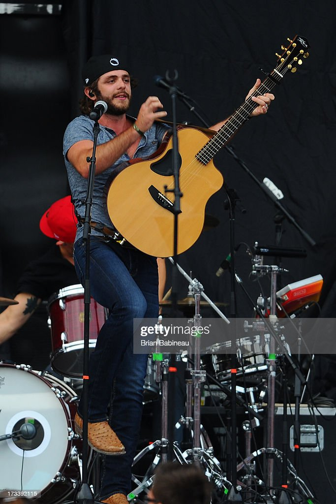 Thomas Rhett performs during the Night Train Tour 2013 at Fenway Park on July 20, 2013 in Boston, Massachusetts.