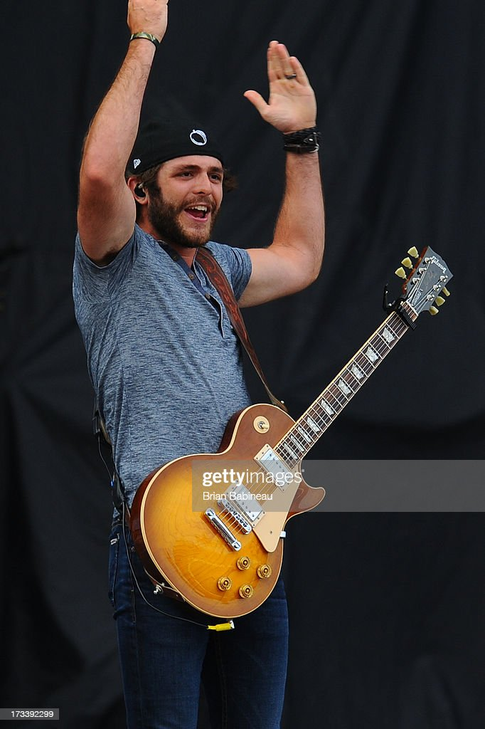 Thomas Rhett performs during the Night Train Tour 2013 at Fenway Park on July 20, 2013 in Boston, Massachusetts.