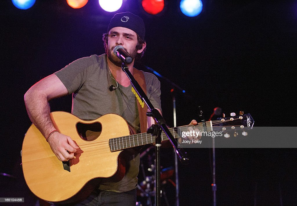 <a gi-track='captionPersonalityLinkClicked' href=/galleries/search?phrase=Thomas+Rhett&family=editorial&specificpeople=9092574 ng-click='$event.stopPropagation()'>Thomas Rhett</a> performs in concert at 8 Seconds Saloon on March 15, 2013 in Indianapolis, Indiana.