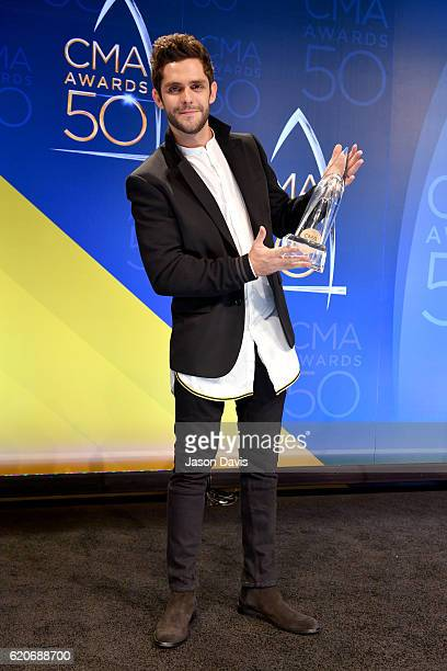 Thomas Rhett poses with award backstage during the 50th annual CMA Awards at the Bridgestone Arena on November 2 2016 in Nashville Tennessee