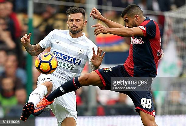 Thomas Rincon of Genoa CFC battles for the ball with Cyril Thereau of Udinese Calcio during the Serie A match between Genoa CFC and Udinese Calcio at...