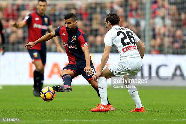Thomas Rincon of Genoa CFC battles for the ball with Sven Kums of Udinese Calcio during the Serie A match between Genoa CFC and Udinese Calcio at...