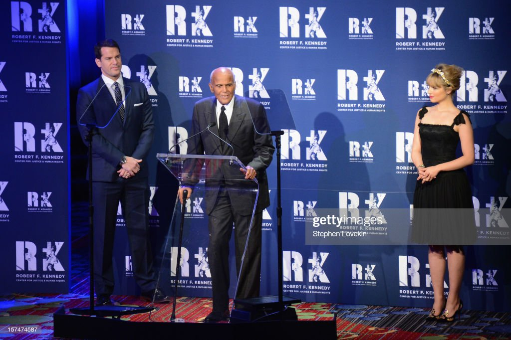 Thomas Roberts, Harry Belafonte, and Dianna Agron speak onstage at the 2012 Ripple Of Hope Gala at The New York Marriott Marquis on December 3, 2012 in New York City.
