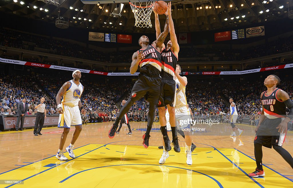 Thomas Robinson #41 and <a gi-track='captionPersonalityLinkClicked' href=/galleries/search?phrase=Joel+Freeland&family=editorial&specificpeople=757235 ng-click='$event.stopPropagation()'>Joel Freeland</a> #19 of the Portland Trail Blazers rebound against the Golden State Warriors on October 24, 2013 at Oracle Arena in Oakland, California.
