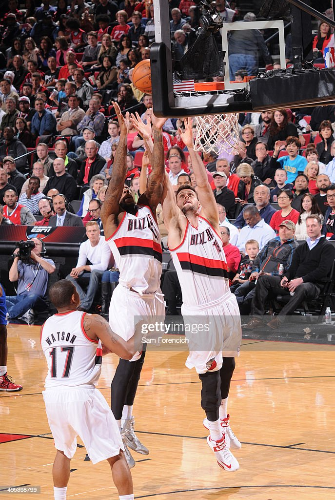 Thomas Robinson and Joel Freeland of the Portland Trail Blazers rebound the ball during the game against the Los Angeles Clippers on April 16 2014 at...