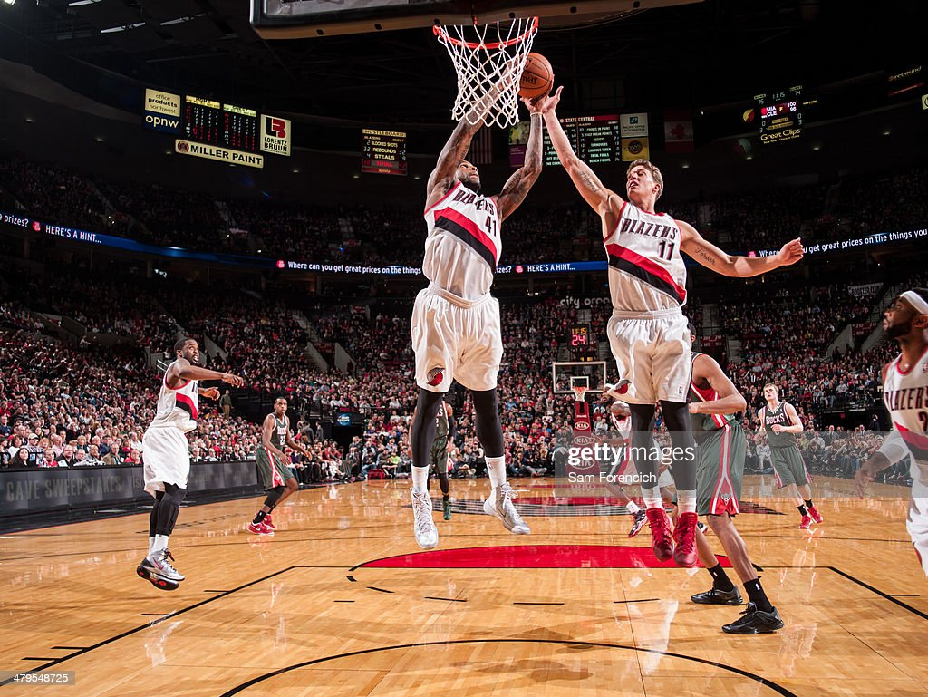 Thomas Robinson #41 and Meyers Leonard #11 of the Portland Trail Blazers goes up for a rebound against the Milwaukee Bucks on March 18, 2014 at the Moda Center Arena in Portland, Oregon.