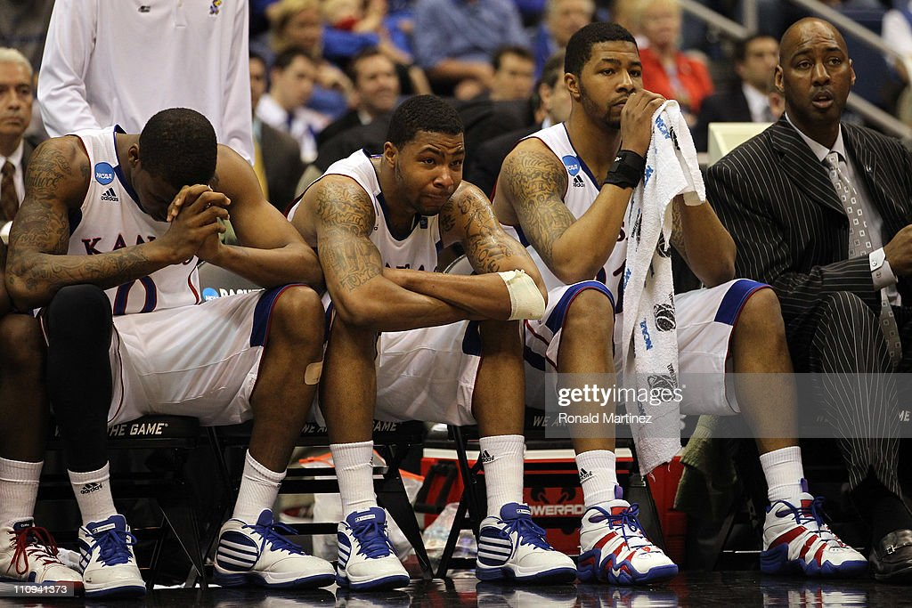 Thomas Robinson #0, Marcus Morris #22, <a gi-track='captionPersonalityLinkClicked' href=/galleries/search?phrase=Markieff+Morris&family=editorial&specificpeople=5293881 ng-click='$event.stopPropagation()'>Markieff Morris</a> #21 and assistant coach <a gi-track='captionPersonalityLinkClicked' href=/galleries/search?phrase=Danny+Manning+-+Basketball+Player&family=editorial&specificpeople=220776 ng-click='$event.stopPropagation()'>Danny Manning</a> react during the southwest regional final of the 2011 NCAA men's basketball tournament at the Alamodome on March 27, 2011 in San Antonio, Texas. Virginia Commonwealth defeated Kansas 71-61.