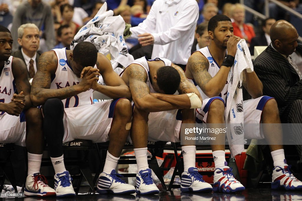 Thomas Robinson #0, <a gi-track='captionPersonalityLinkClicked' href=/galleries/search?phrase=Markieff+Morris&family=editorial&specificpeople=5293881 ng-click='$event.stopPropagation()'>Markieff Morris</a> and Marcus Morris #22 of the Kansas Jayhawks react afterduring the southwest regional final of the 2011 NCAA men's basketball tournament at the Alamodome on March 27, 2011 in San Antonio, Texas.