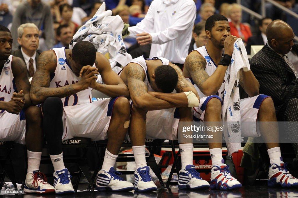 Thomas Robinson Markieff Morris and Marcus Morris of the Kansas Jayhawks react afterduring the southwest regional final of the 2011 NCAA men's...
