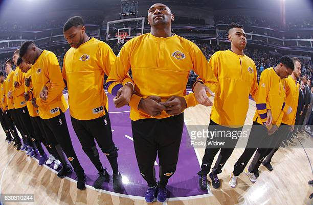 Thomas Robinson Metta World Peace and D'Angelo Russell of the Los Angeles Lakers link arms with teammates during the national anthem of the game...