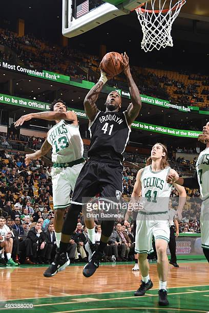 Thomas Robinson of the Brooklyn Nets goes for the layup against James Young of the Boston Celtics during the preseason game on October 19 2015 at TD...