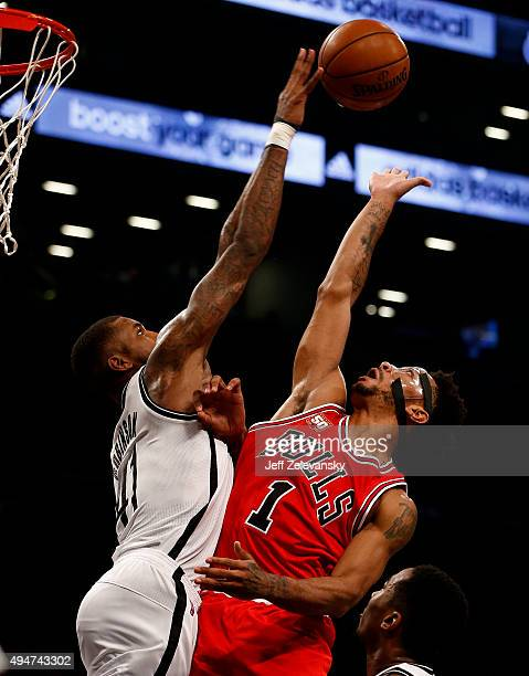 Thomas Robinson of the Brooklyn Nets guards Derrick Rose of the Chicago Bulls during a game at Barclays Center on October 28 2015 in the Brooklyn...
