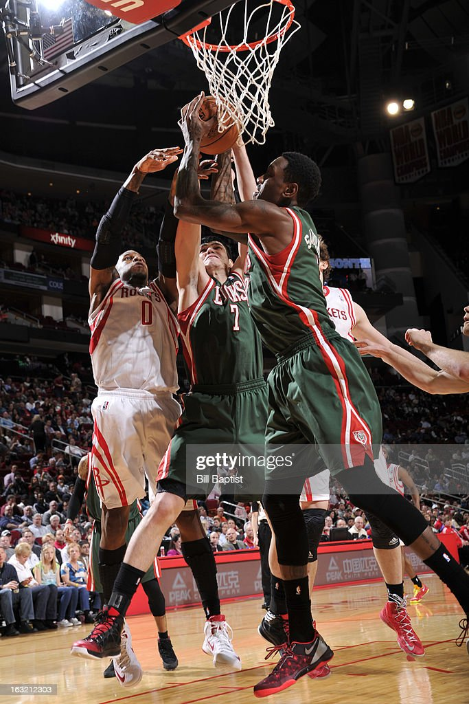 Thomas Robinson #0 of the Houston Rockets and <a gi-track='captionPersonalityLinkClicked' href=/galleries/search?phrase=Ersan+Ilyasova&family=editorial&specificpeople=557070 ng-click='$event.stopPropagation()'>Ersan Ilyasova</a> #7 and Larry Sanders #8 of the Milwaukee Bucks go up for a rebound on February 27, 2013 at the Toyota Center in Houston, Texas.