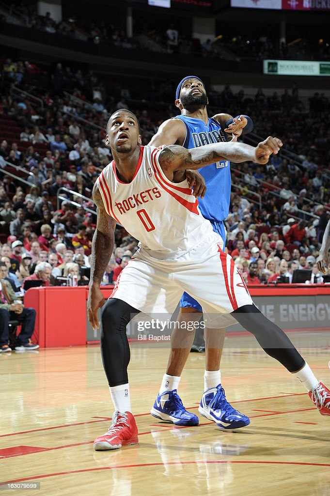 Thomas Robinson #0 of the Houston Rockets fights for position against <a gi-track='captionPersonalityLinkClicked' href=/galleries/search?phrase=Vince+Carter&family=editorial&specificpeople=201488 ng-click='$event.stopPropagation()'>Vince Carter</a> #25 of the Dallas Mavericks on March 3, 2013 at the Toyota Center in Houston, Texas.