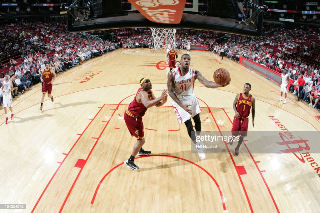 Thomas Robinson #41 of the Houston Rockets shoots the ball against <a gi-track='captionPersonalityLinkClicked' href=/galleries/search?phrase=Kevin+Jones+-+Basketball+Player&family=editorial&specificpeople=15316205 ng-click='$event.stopPropagation()'>Kevin Jones</a> #5 of the Cleveland Cavaliers on March 22, 2013 at the Toyota Center in Houston, Texas.