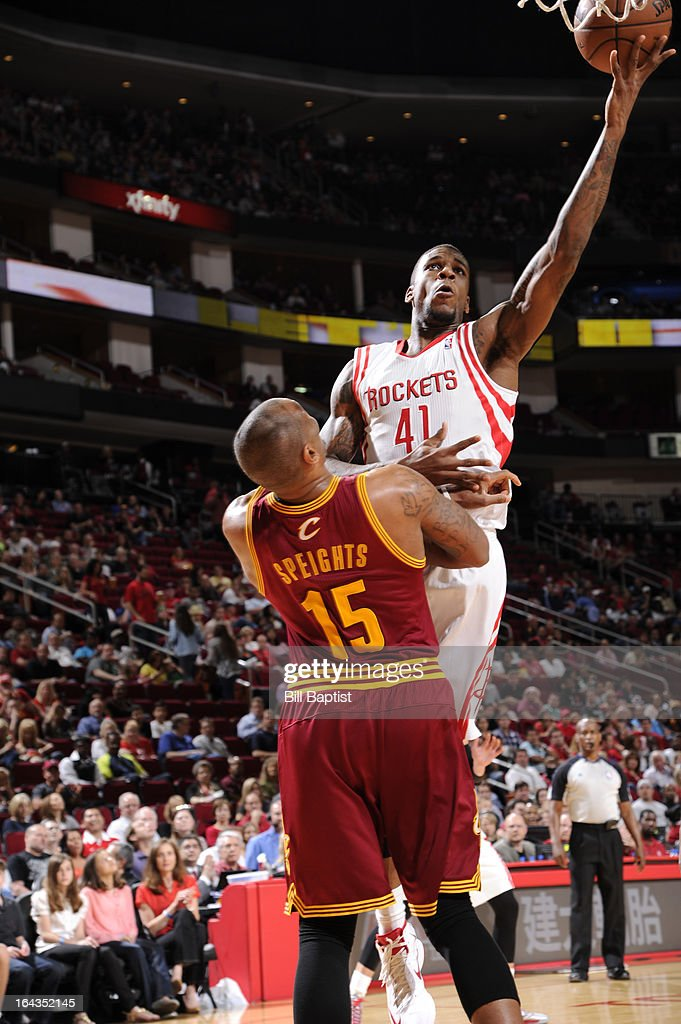 Thomas Robinson #41 of the Houston Rockets shoots the ball against Marreese Speights #15 of the Cleveland Cavaliers on March 22, 2013 at the Toyota Center in Houston, Texas.