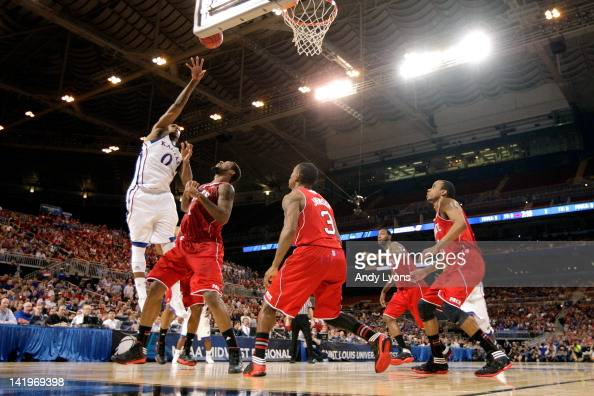 Thomas Robinson of the Kansas Jayhawks attempts a shot against Richard Howell of the North Carolina State Wolfpack during the 2012 NCAA Men's...