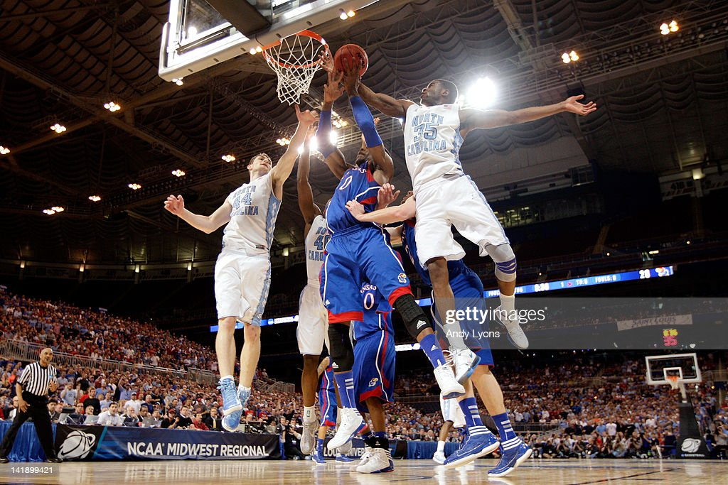 Thomas Robinson #0 of the Kansas Jayhawks fights for a rebound in the first half against <a gi-track='captionPersonalityLinkClicked' href=/galleries/search?phrase=Tyler+Zeller&family=editorial&specificpeople=5122156 ng-click='$event.stopPropagation()'>Tyler Zeller</a> #44 and Reggie Bullock #35 of the North Carolina Tar Heels during the 2012 NCAA Men's Basketball Midwest Regional Final at Edward Jones Dome on March 25, 2012 in St Louis, Missouri.
