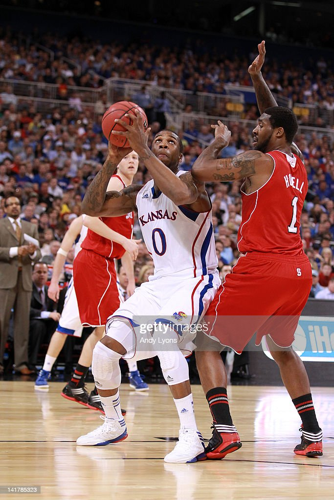 Thomas Robinson #0 of the Kansas Jayhawks looks to go up for a shot in the first half against <a gi-track='captionPersonalityLinkClicked' href=/galleries/search?phrase=Richard+Howell&family=editorial&specificpeople=2313901 ng-click='$event.stopPropagation()'>Richard Howell</a> #1 of the North Carolina State Wolfpack during the 2012 NCAA Men's Basketball Midwest Regional Semifinal at Edward Jones Dome on March 23, 2012 in St. Louis, Missouri.