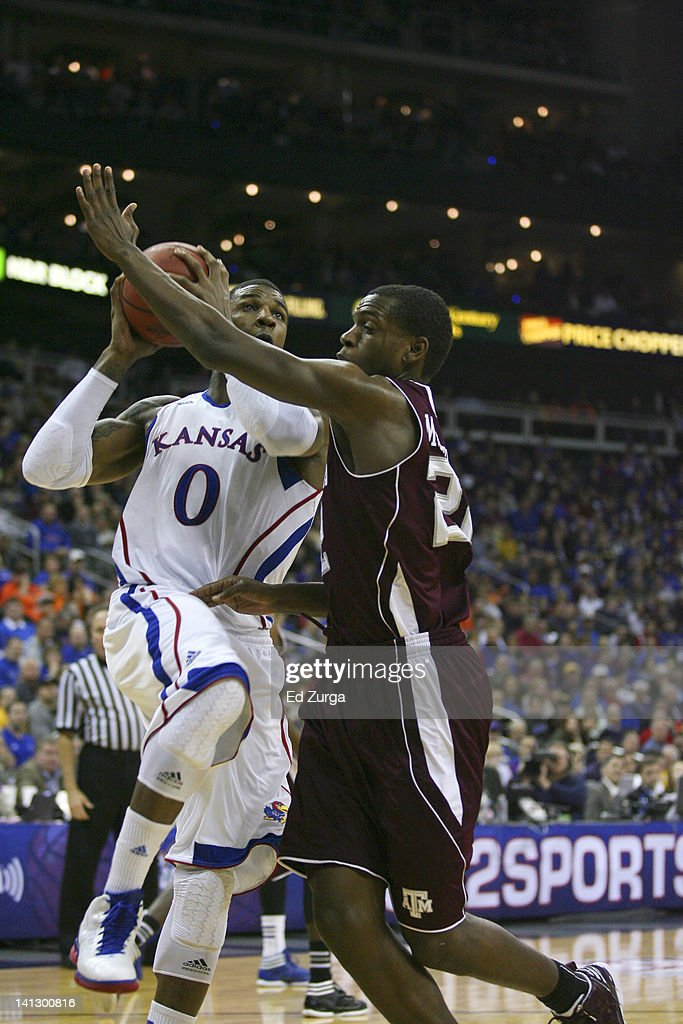 Thomas Robinson #0 of the Kansas Jayhawks shoots against Khris Middleton #22 of the Texas A&M Aggies during the quarterfinals of the Big 12 Basketball Tournament March 8, 2012 at Sprint Center in Kansas City, Missouri.