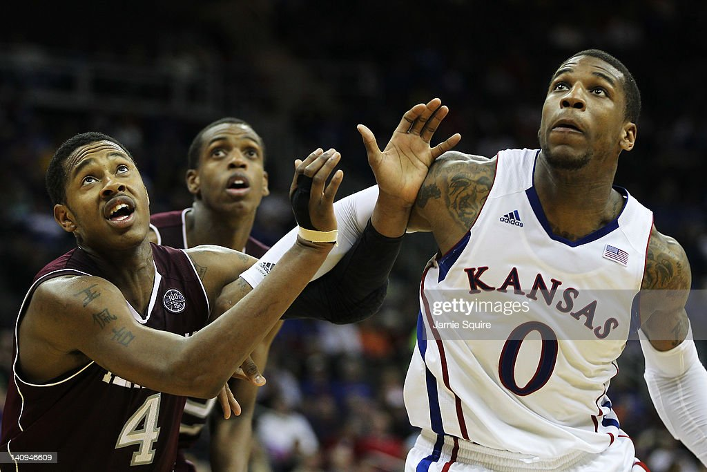Thomas Robinson #0 of the Kansas Jayhawks vies for position with <a gi-track='captionPersonalityLinkClicked' href=/galleries/search?phrase=Keith+Davis&family=editorial&specificpeople=580211 ng-click='$event.stopPropagation()'>Keith Davis</a> #4 and Khris Middleton #22 of the Texas A&M Aggies in the second half during the quarterfinals of the 2012 Big 12 Men's Basketball Tournament at Sprint Center on March 8, 2012 in Kansas City, Missouri.