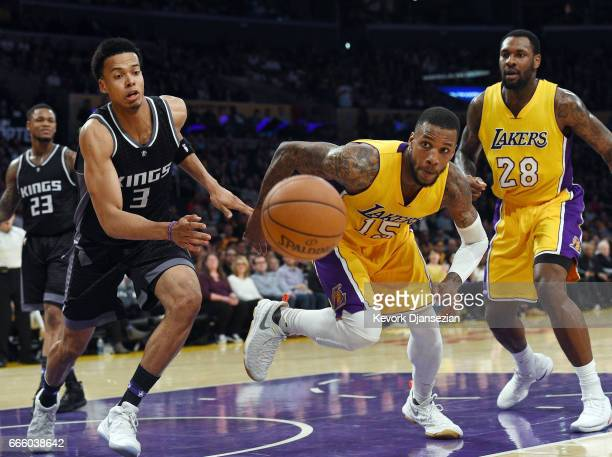 Thomas Robinson of the Los Angeles Lakers and Skal Labissiere of the Sacramento Kings battle four the ball during the second half of the basketball...