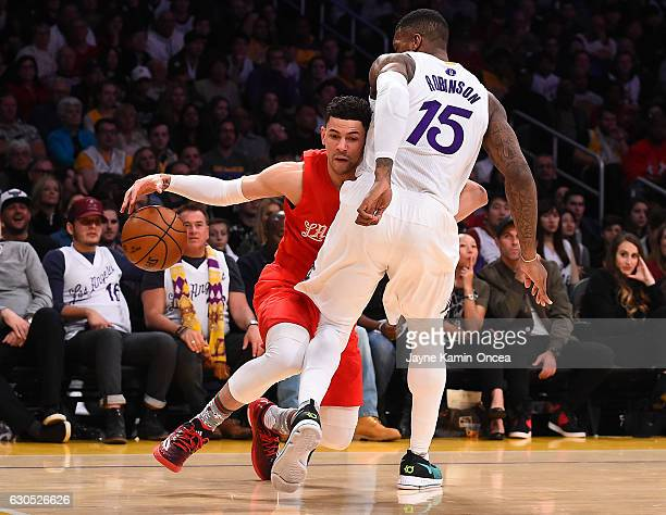 Thomas Robinson of the Los Angeles Lakers guards Austin Rivers of the Los Angeles Clippers as he drives to the basket in the first half of the game...